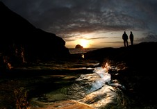 A couple enjoying the view as the sun sets over Trebarwith Strand. Photographer Kyle Harman, Bowling Green.